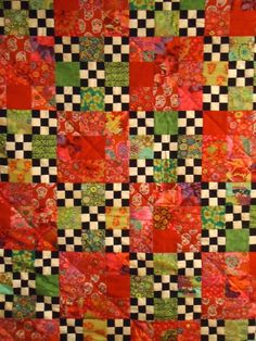 Done up in Kaffe Fassett's reds and greens.