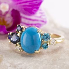 All shades of blue in this turquoise sapphire topaz and diamond cluster ring available in our  @etsy shop #zmayjewelry