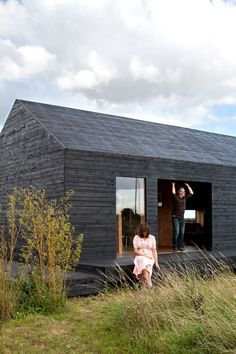 30 All-Black Exterior Modern Homes - Photo 16 of 30 - Carl Turner and Mary Martin pose on the porch of the Stealth Barn, a multipurpose structure that plays as a guest cottage, office space, and escape from whatever may be cooking at Ochre Barn. Modern Exterior, Exterior Design, Black Exterior, Exterior Paint, Exterior Colors, Casa Bunker, Casas Containers, Timber Cladding, Cladding Ideas