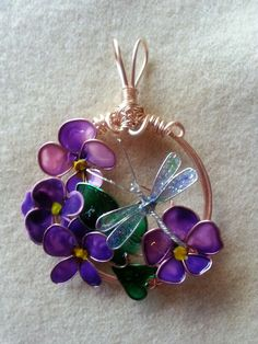 My latest wire and nail polish . . . I used some faux stained glass paint as well.