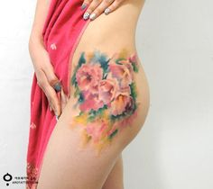Beautiful Floral Tattoos Resemble Delicate Watercolor Paintings on Skin