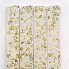 This traditional Italian nougat is typically made with almonds, but we've substituted pistachios for their bright color and delicate flavor. Torrone can vary from firm to soft, but this one has a nice, subtle chew. Flavorless sheets of edible wafer paper keep the strips from sticking to one another.