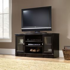 "Features:  -2 Adjustable exterior shelves hold audio/video equipment.  -Adjustable shelf behind each framed, safety-tempered glass door.  -Finish: Estate Black.  TV Size Accommodated: -50"".  Product T"