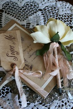 Alice in Wonderland Guest Book with Vintage Style Flower Pen - Sign Me tag, moleskine journal, flower pen- choose ribbon and theme. $26.95, via Etsy.