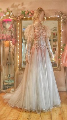 high neck silk organza and tulle wedding dress with long puff sleeves. The stylised sunflower and geometric foliage embroidery, together w. Tulle Wedding, Wedding Dresses, Event Dresses, Fairytale Dress, Fairy Dress, Fantasy Gowns, Festa Party, Beautiful Gowns, Dream Dress