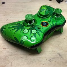 A Friendly 420 Xbox 360 Controller with Modsticks Triggers and Thumbsticks and Zombie Guide Button  #420 #potleaf #weed #stoner #weedcontroller #modsticks #modstickspro #modstickstriggers #kwikboymodz #customcontroller #xbox360 #xbox360controller  http://www.kwikboymodz.com/friendly-420-xbox-360-controller/