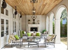 Ceiling fans do not need to hang from the middle of the ceiling. Here, lanterns occupy the center line of this outdoor room's ceiling, while Old Havana fans circulate the air from the sidelines.