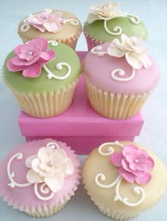Beautiful floral cupcakes in pastel shades