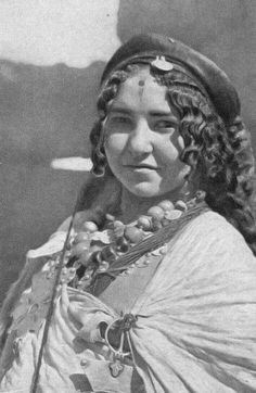 """Africa   Ait Wanougdal woman. ca. 1930s/40s   From a series of images uploaded by the 'Tiwizi Association Berbero Suisse' that have been scanned from either J.Robichez (1946), """"Central Morocco,"""" Editions B. Arthaud, Grenoble-Paris OR from the publication G. Camp (2002), """"The Berbers. Memory and Identity,"""" Wandering Editions, Paris"""