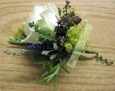 Rose and herb buttonholes.