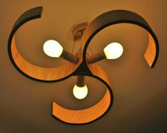 """This lamp looks like a screw propeller from a ship. 3 energy save bulbs give much of warm """"wooden"""" light, so it fits to even large rooms. The plywood is oiled. Wooden Chandelier, Wood Lamps, Design Your Home, Light Oak, Wood Texture, Lamp Design, Home Interior, Pendant Lamp, Lamp Light"""