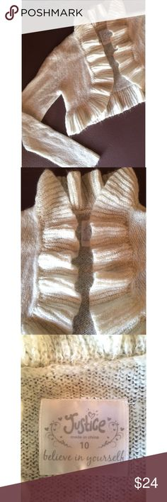 """🎀Adorable Cream Cardigan Sweater🎀 Beautiful ruffled front. Silver specks throughout add a playful, feminine feel.  Lightweight & delicate.   69% Acrylic 25% Nylon 6% Other fibers.   12"""" Long x 16"""" Wide.  22"""" Sleeves.   NEW!  Original Sample.  Great condition. Justice Shirts & Tops Sweaters"""