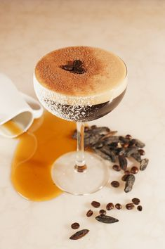 The Café Millonario features coffee-washed Bacardi Black rum, espresso, Tonka bean-infused maple syrup, dark chocolate syrup, and bitters, plus a shower of chocolate powder and a trio of coffee beans on top.