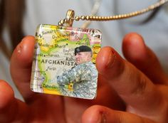 """Since daddy is getting ready to deploy our daughter wanted to wear something that symbolizes where he will be at.  We made this glass tile necklace with a piece of a map.  """"His boots maybe here, but his footprints are on her heart."""" HOOAH!"""