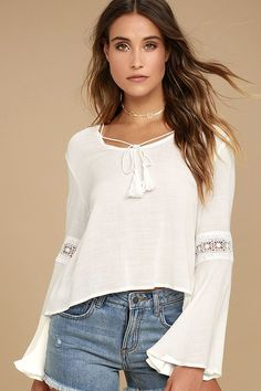 Bask in the wonder of everything around you in the Run Wild White Lace Long Sleeve Top! Gauzy woven rayon shapes a drawstring neckline with tasseled ties, and billowing bell sleeves with crochet lace insets. Breezy bodice with a cropped, high-low hem.
