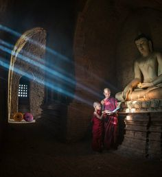 "danielwamba: "" Photograph by Zay Yar Lin Source of Light Two novices reading and learning a book with the help of rays of morning sun light coming inside a temple in Bagan, Myanmar "" Sun Light, Spiritual Path, Bagan, Morning Sun, Pilgrimage, The Help, Paths, Temple, Tourism"