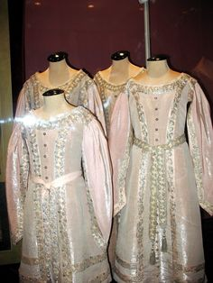 That famous great dresses of 1900s of Grand Duchesses Olga, Tatiana, Marie, and Anastasia Romanov. Dresses are performed in the style of ancient Russia. Girls are dressed in them on some photos