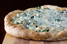 White Chicken Pizza with Basil and Spinach.