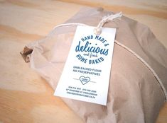 Don't think the kraft wrap is a good option, but like the idea of a tag - easy to print and customize upfront.