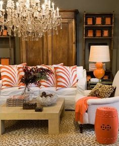 Dark grey walls, orange accents, white and crustal, rustic wood.