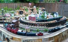 Brenda and Greg Cauthen built this model railway. To see Greg and Brenda Cauthen's lovely, Tuscan-style home on its leafy neighborhood street, you'd never guess what lies beyond. Silverton Train, Garden Railings, Tuscan Style Homes, Garden Railroad, Top Soil, Model Train Layouts, Real Plants, Mountain Landscape, Model Trains
