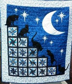 Here is a paper pieced star quilt called 'Nightime Cat Antics'. The traditional star blocks look great in this cot quilt creating a fabulous set of steps for the cats to play on at night time. I loved making this quilt.