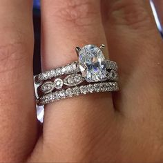 oval engagement ring with mix and match wedding ring stack