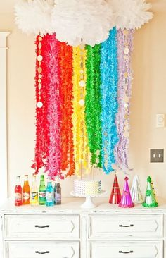DIY Tissue Paper Cloud Pom Poms & Rainbow Garland (http://www.intimateweddings.com/blog/tissue-paper-pom-poms-diy-wedding-decor/)