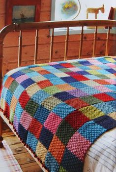 "Great idea: ""For this blanket, Jane used double moss stitch and knit five ""scarves"" that were then sewn into one big blanket."" Find a scarf pattern (or two) and then make scarves in to a blanket. More interesting than knitting a whole blanket! Crochet Quilt, Knit Or Crochet, Crochet Scarves, Blanket Crochet, Patchwork Blanket, Knit Squares Blanket, Easy Knit Blanket, Knitting Squares, Patchwork Ideas"