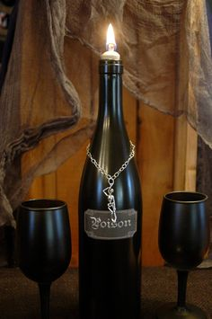 Simple, Elegant and Deadly Wine Bottle and matching Wine Glasses for an eerie Halloween display. $24.00, via Etsy.