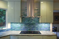 Mist, a hand cut jewel glass mosaic, shown in blue, white and green stalks.<br /> -photo coutesy of Ambiente Tile Decorative Tile Backsplash, Stone Backsplash, Mosaic Backsplash, Kitchen Backsplash, Backsplash Ideas, Bath Design, Tile Design, Ravenna Mosaics, New Ravenna