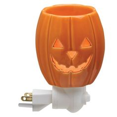 Jack O' Lantern Plug-In Scentsy Warmer    Illuminated from within, Jack O' Lantern is a smaller version of a holiday favorite—this carved pumpkin is sure to be a spooky delight!