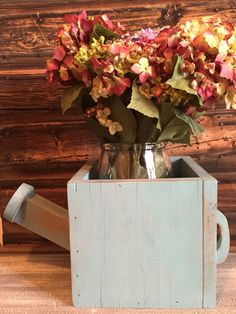 Rustic watering can planter - painted in Annie Sloan Provence, and distressed. Clear waxed for durability. ~The Decor Vault~ www.facebook.com/thedecorvault