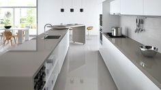 Dark benchtop and light grey splashback More