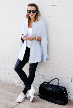 fall / winter - street style - street chic style - fall outfits - casual outfits - comfy outfits - light blue cape + white t-shirt + black skinny jeans + white sneakers + black handbag + black sunglasses