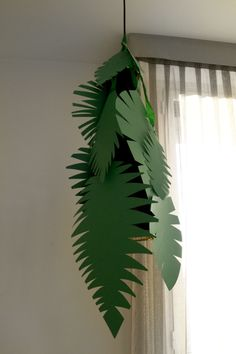 Jungle party_leaves decoration lamp. Adding  glow sticks inside could be neat.