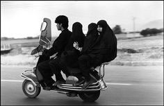 IRAN. Shahr Rey. Young man, three veiled girls in a four-seater motorbike. 1997. photo by Abbas