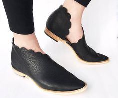 Rilee Shoes - Handcrafted in the USA Refresh your spring style with effortless footwear. The modern and asymmetrical scalloped cut wraps your ankles gracefully, the black a clean contrast color. Rilee Shoes are traditionally handcrafted using rich leathers that only get more beautiful