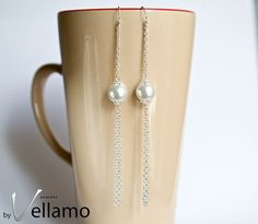 Long statement sterling silver earrings with white pearls by byVellamo, $29.00