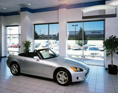 Solar shades are perfect for an auto dealership. They block the sun's harmful rays while allowing the salesmen a good view of the lot.