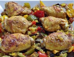 Simple Phase 3 supper for the #FastMetabolismDiet Scatter veggies on a roasting pan, sprinkle with Moroccan spices and layer chicken thighs and more spices on top. Easy!
