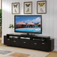 Available in two finishes, this 84-inch TV stand is a sure fit for any living space. The spacious shelving compartments and convenient cabinet and drawers pair wonderfully to create the ultimate entertainment center.