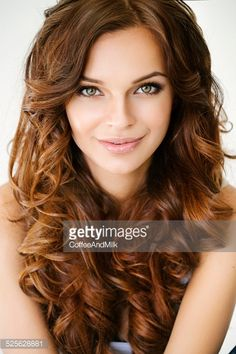 Stock Photo : Studio shot of young beautiful woman