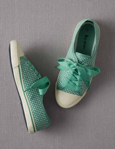 Spotty Canvas Plimsolls @BodenClothing. Minty, polka dot sneakers with wide ribbony laces? How cute is that?!