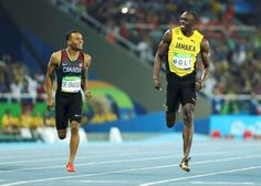 Usain Bolt of Jamaica and Andre De Grasse of Canada compete in the men's 200m semifinals at the Rio Olympics August 17, 2016.
