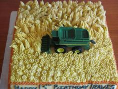 John Deere Combine Cake So easy! I used a grass tip for the wheat field and then flattened the tips with my finger to give an even...