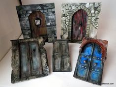Made with paper, cardboard, chipboard and acrylic paint. Amazing results.