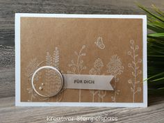 handmade card .... Flowering Fields stamped in white on kraft ... like the circle medallion anchoring the vellum banner with the sentiment ... Stampin' Up!