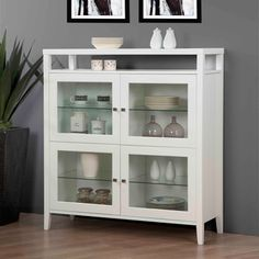 @Overstock - Complete your home decor with this white Aristo cabinet. A four-door design and spacious shelving finish this durable, stylish cabinet.   http://www.overstock.com/Home-Garden/Aristo-Gloss-White-Four-Door-Cabinet/6624951/product.html?CID=214117 $429.99