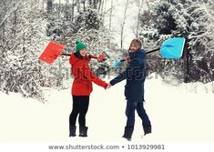 Happy couple with snow shovels on rural road. Winter fun